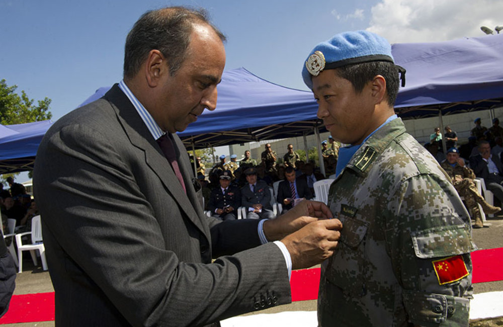 UNIFIL Deputy Head of Mission and Director of Political and Civil Affairs Imran Riza awarding a medal to a peacekeeper during the International Day of Peace ceremony.