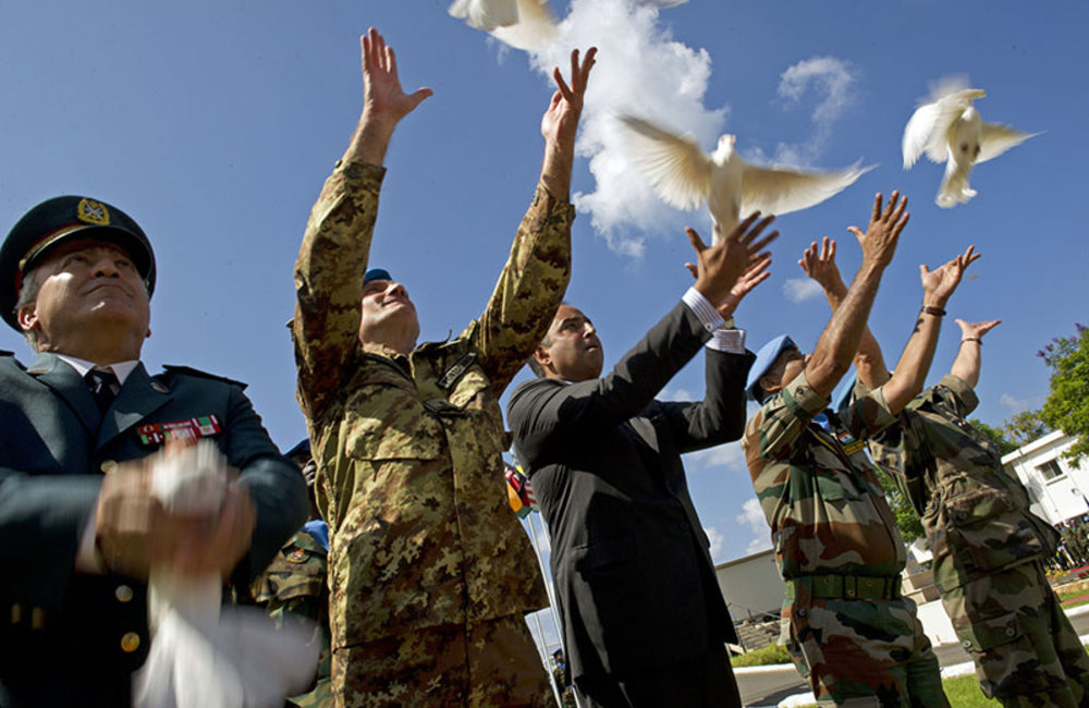 Releasing doves at the end of the ceremony marking International Day of Peace.