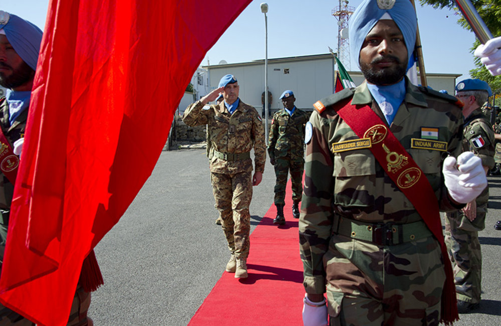 UNIFIL Head of Mission and Force Commander Major-General Luciano Portolano saluting the Guard of Honor at UN Day ceremony.