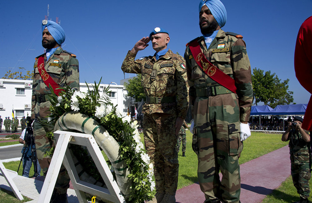 Head of Mission and Force Commander Major-General Portolano laying wreaths at the UNIFIL cenotaph in memory of fallen peacekeepers during UN Day.