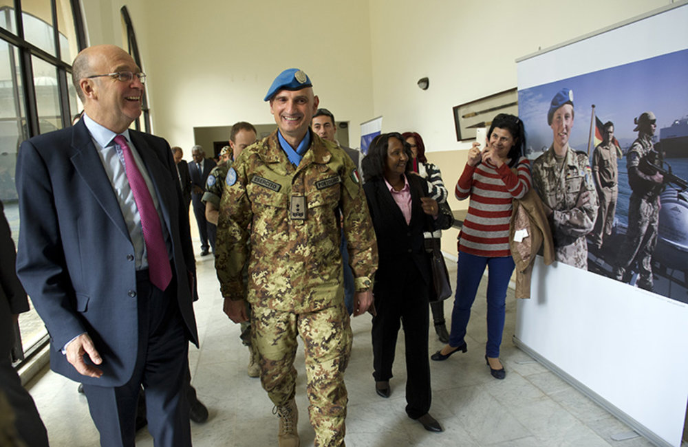 UN Special Coordinator for Lebanon, Mr. Derek Plumbly, Force Commander Maj.-Gen. Luciano Portolano and Gender Advisor Ms Afaf Omer view the photography exhibition.