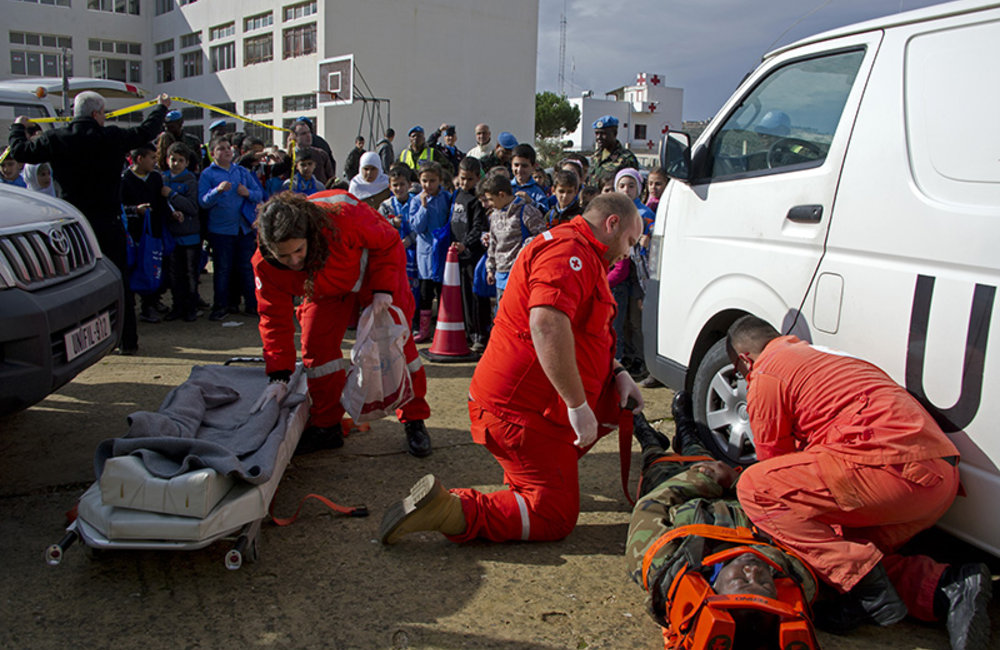Lebanese Red Cross demonstrate emergency medical procedures for the children to familiarize them with the dangers of the road.