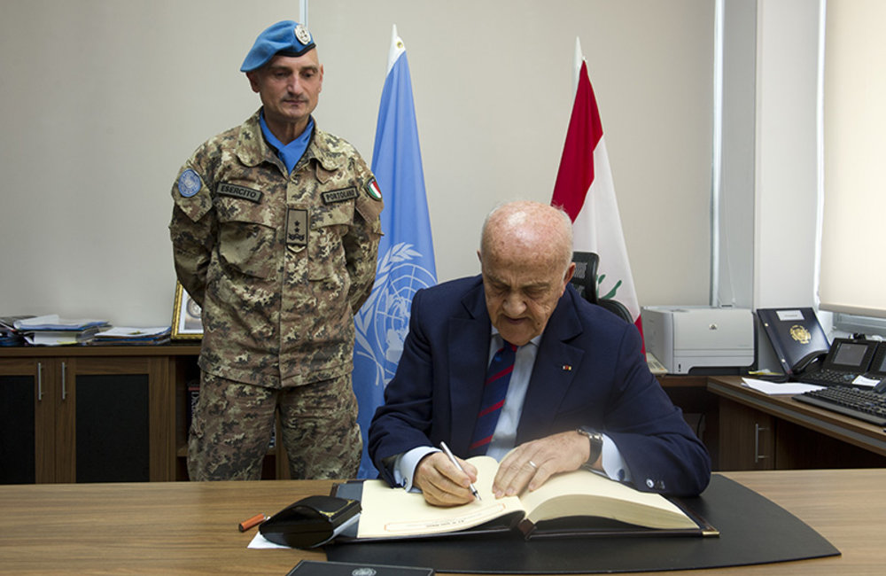 Deputy Prime Minister and Minister of Defense, Samir Moqbel signs the Book of Honour at the UNIFIL headquarters in Naqoura.