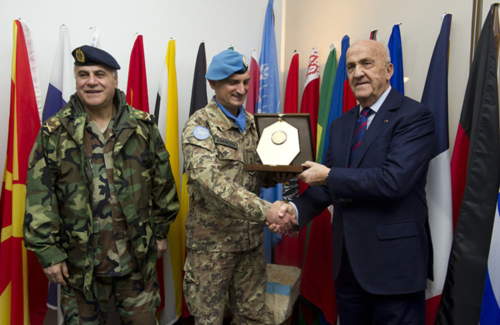 UNIFIL Force Commander Major-General Luciano Portolano receives a plaque from the Deputy Prime Minister and Minister of Defense, Samir Moqbel at the UNIFIL headquarters in Naqoura.