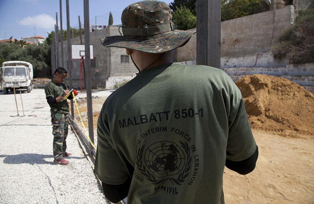 UNIFIL Malbatt engineers preparing fence of mini-football field in Mazraat al-Meshref, south Lebanon.