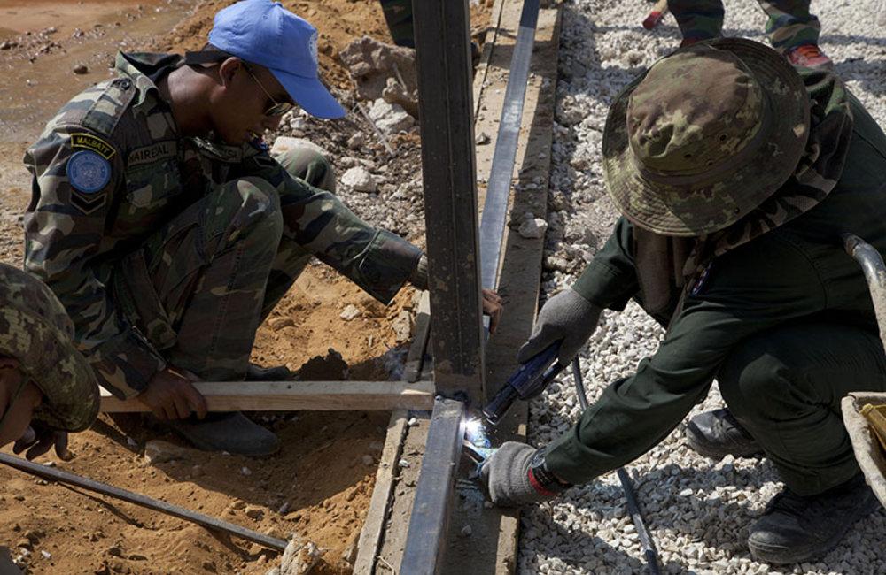 Engineers welding bracing of the field fence in Mazraat al-Meshref, south Lebanon.