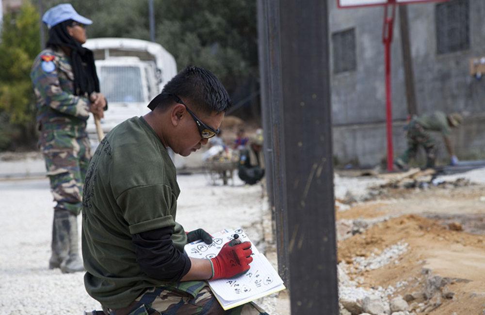 UNIFIL Malbatt engineers preparing fence installation of the field of Mazraat al-Meshref, south Lebanon.