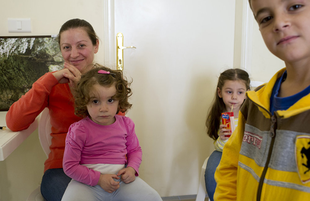 A family waits to see the Serbian medical team of UNIFIL CIMIC operations in Deir Mimas, south Lebanon.