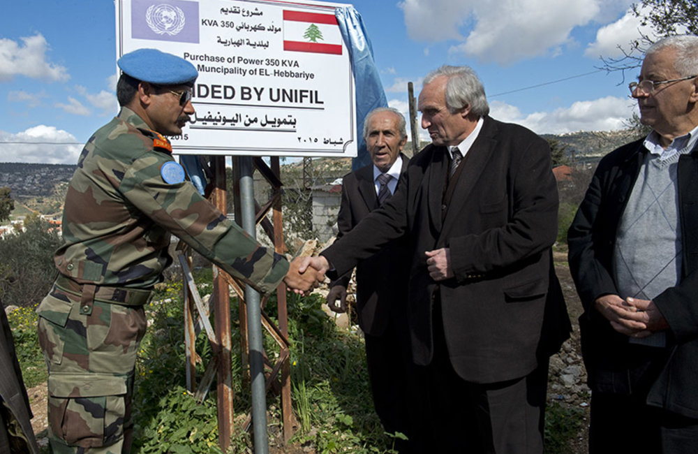 UNIFIL Indian Battalion Commander Colonel Rajesh Dahiya and Qaem Maqam of Hasbaya Mr. Walid Ghafir unveiling a plaque during the handover ceremony in Hebbariyeh.