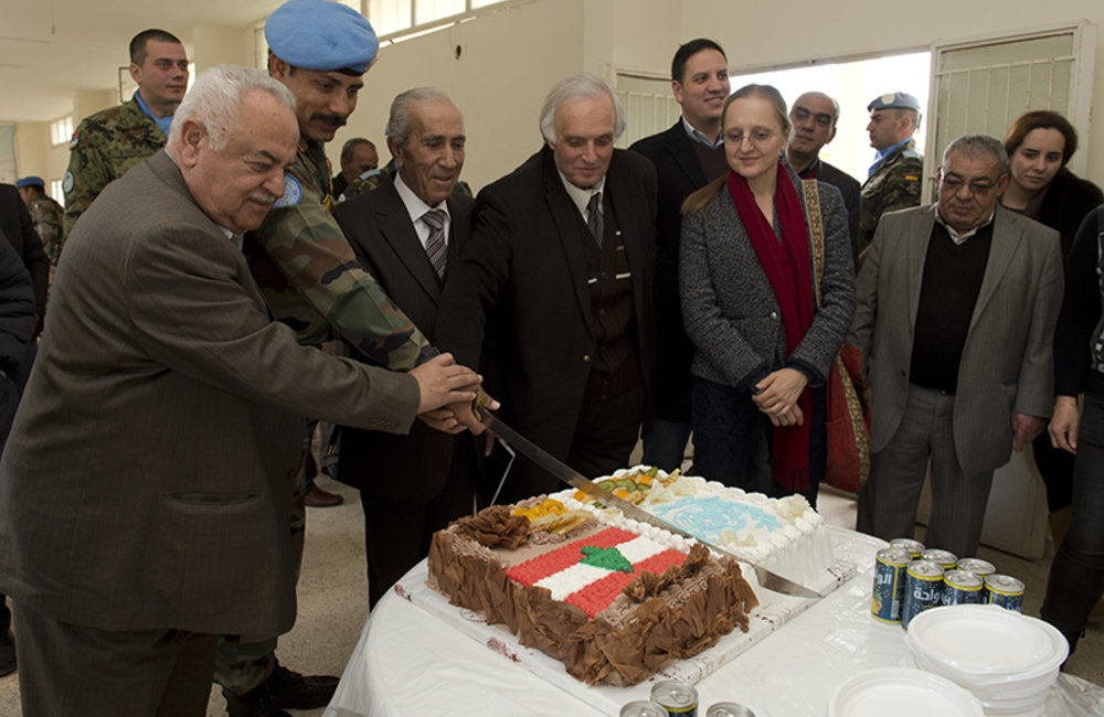 Representatives of Local authorities, UNIFIL Civil Affairs officials and Indian Battalion Commander cutting the cake at the Municipality in Hebbariyeh.