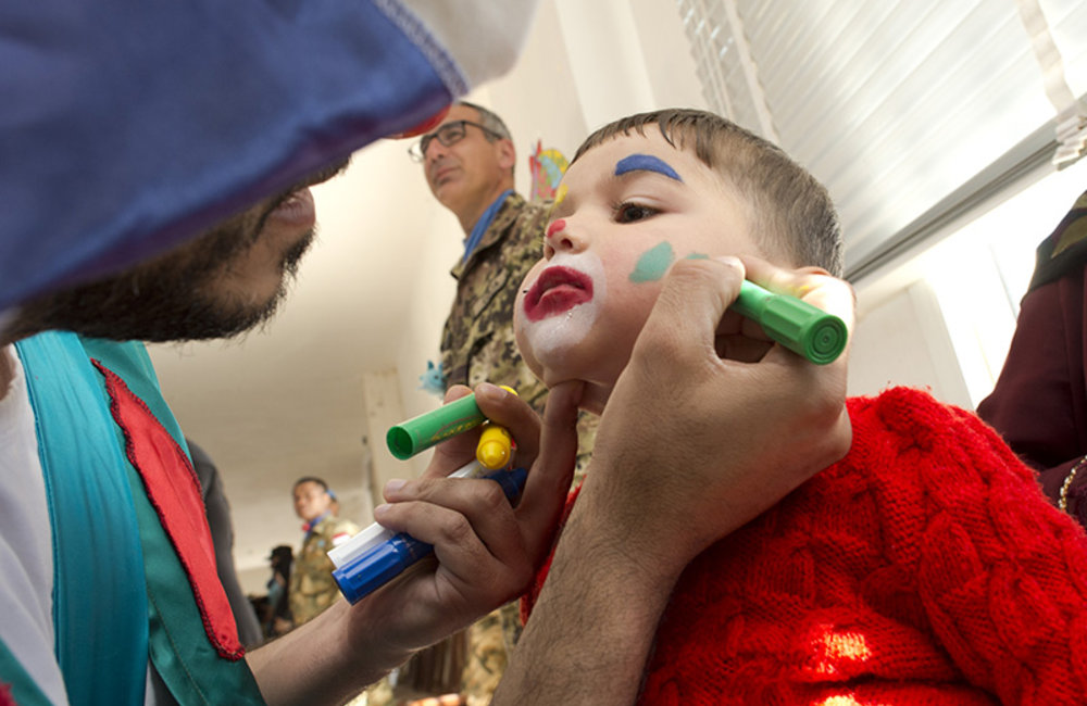 Face painting activity at Ayta Shaab Care Centre for Children with Special Needs during clown therapy event organized by UNIFIL.