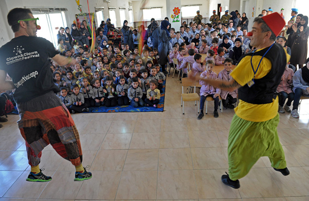 Clowns performing in front of cheerful children at Ayta Shaab Care Centre for Children with Special Needs during clown therapy event organized by UNIFIL.