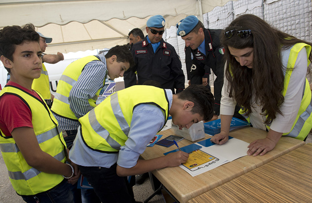 UNIFIL Road Safety Campaign - Students signing the road safety workshop's certificates at UNIFIL's Sector West HQ in Shama.