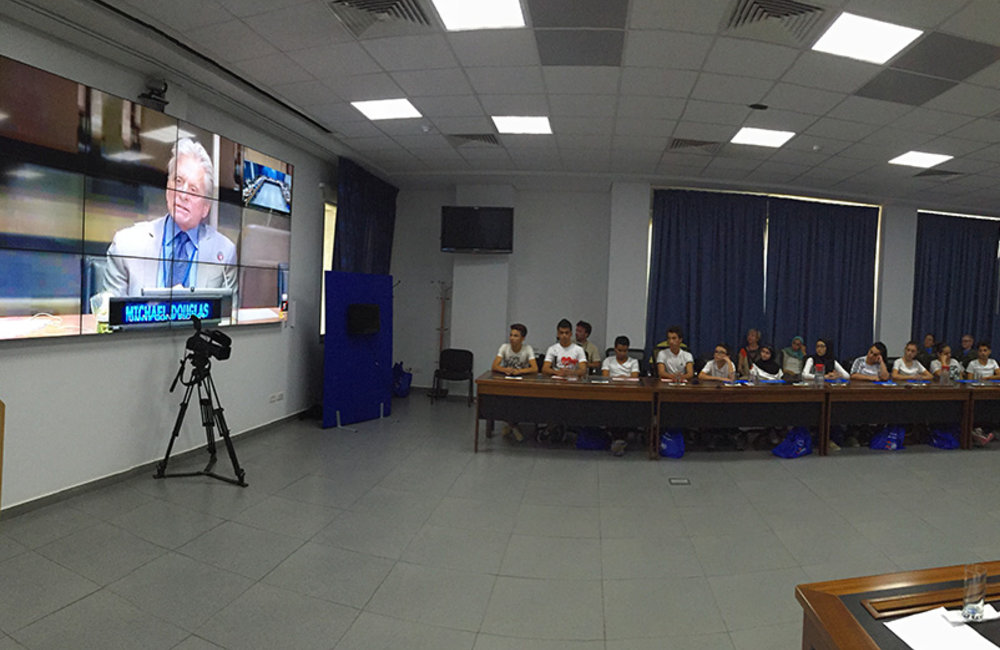 Messenger of Peace Michael Douglas addressing students at UN HQ and UNIFIL during a video conference in the occasion of International Day of Peace.