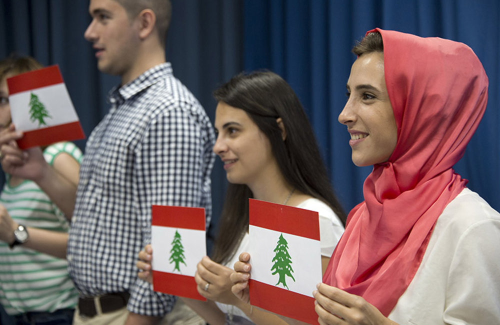 Lebanese students showing Lebanese flags during world flag ceremony on the occasion of International Day of Peace at UNIFIL HQ in Naqoura.