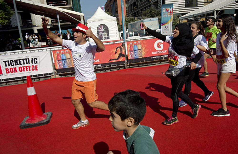 Lebanese family celebrating arrival at the finish line.