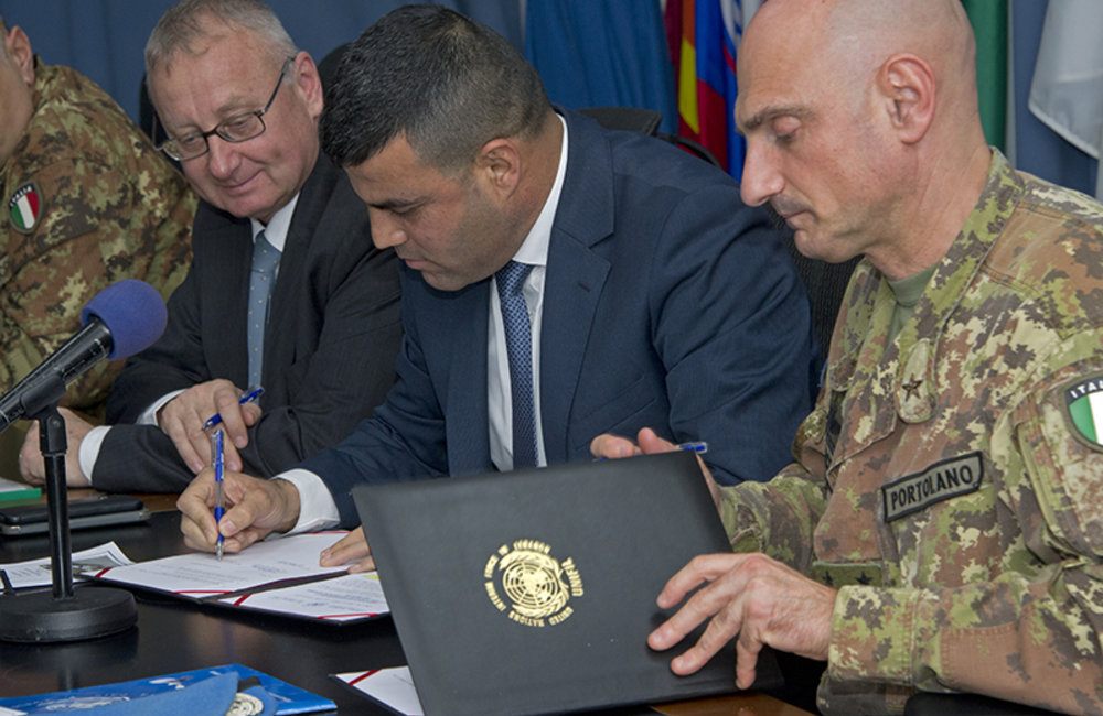 Lieutenant Colonel Fawzi Shamoun representing General Security signs the hand-over certificate during the ceremony held at UNIFIL headquarters in Naqoura, South Lebanon.
