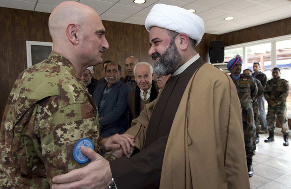UNIFIL Head of Mission and Force Commander Major-General Luciano Portolano welcoming Sheik Hassan Abdallah to the meeting of local authorities and religious leaders held at UNIFIL Headquarters in Naqoura.
