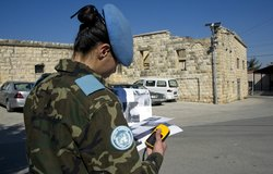 A UNIFIL Spanish Peacekeeper reviews the installation of solar street lighting in Ibl al-Saqi.
