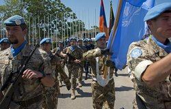 Peacekeepers representing 40 national contingents march ahead of a UNIFIL ceremony marking the International Day of UN Peacekeepers.