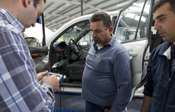 Trainees checking the vehicle tester results during the vocational training at UNIFIL HQ
