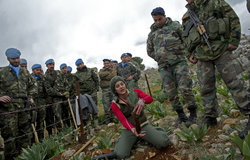 Jouzour Loubnan (NGO) member demonstrates to the Lebanese Armed Forces and UNIFIL how to plant the trees in the town of Ibel al-Saqi.