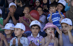 Children clapping hands while watching the performances at the Spring Festival in As Sultanieh, South Lebanon.