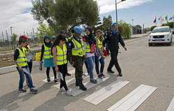 UNIFIL Road Safety Campaign - UNIFIL military police helping students at a pedestrian crossing at UNIFIL's Sector West HQ in Shama.