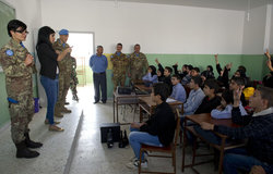 UNIFIL's MCOU team explaining the Blue Line to the children of the Jibayl Al Butm school.