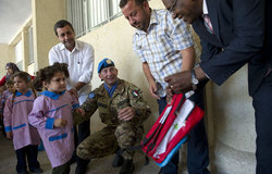 Albagir Adam, Chief of Civil Affairs handing out a school bag at Naqoura School, 05 November 2012