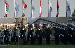 Lebanese Armed Forces (LAF) cadets hold their swords at the graduation ceremony marking Lebanese Army Day.