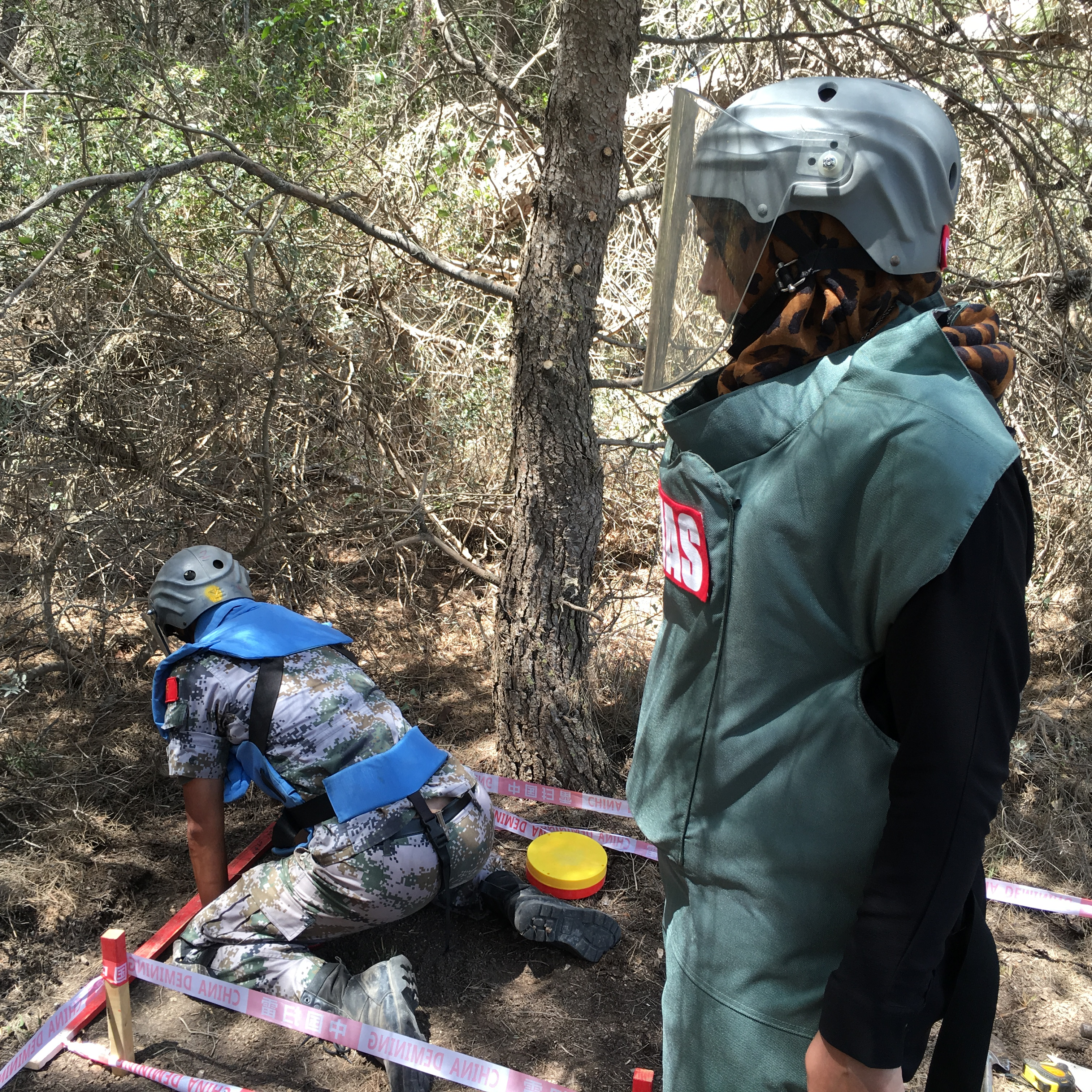 UNMAS Lebanon QA officer is conducting quality assurance on mine clearance procedures on Chinese deminer to make sure it is conducted in line with SOP